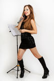 Portrait of a young beautiful woman in black dress singing Royalty Free Stock Photo