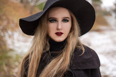 Portrait of a young beautiful woman in black hat retro style. Royalty Free Stock Photos