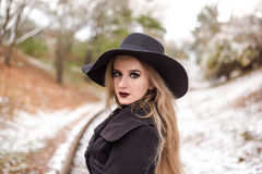 Portrait of a young beautiful woman in black hat retro style. Royalty Free Stock Images