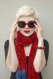 Woman blonde in red scarf, sunglasses. Fashion haircut, accessories. Royalty Free Stock Photos
