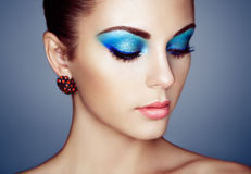 Portrait of young beautiful woman with blue makeup Stock Photo