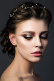 Portrait of young beautiful woman with bridal makeup and coiffur. E. Modern smokey eyes make up. Studio shot. Salon make-up Royalty Free Stock Photography