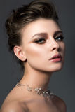 Portrait of young beautiful woman with bridal makeup and coiffur royalty free stock photography