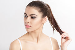 Portrait of young beautiful woman brunette with natural makeup. girl with clean skin Stock Photography