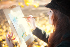 Portrait of a young beautiful woman with a brush in her hand Stock Images