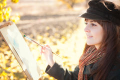 Portrait of the young beautiful woman with a brush in her hand Stock Photos