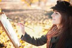 Portrait of the young beautiful woman with brush Stock Image