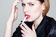 Portrait of young beautiful woman with cigarette Royalty Free Stock Photography