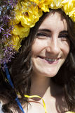 Portrait of young beautiful woman with circlet of flowers Royalty Free Stock Images