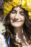 Portrait of young beautiful woman with circlet of flowers Stock Images