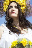 Portrait of young beautiful woman with circlet of flowers Stock Photos