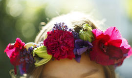 Portrait of young beautiful woman circlet of flowers on head Royalty Free Stock Images