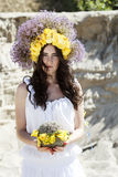 Portrait of young beautiful woman with circlet of flowers Royalty Free Stock Image