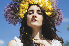 Portrait of young beautiful woman circlet of flowers on head Royalty Free Stock Photography