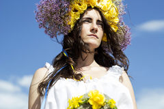 Portrait of young beautiful woman with circlet of flowers on head Royalty Free Stock Photo
