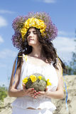 Portrait of young beautiful woman with circlet of flowers on her. Portrait of young beautiful woman circlet of flowers on head outdoors Royalty Free Stock Photo