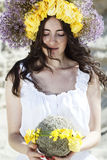 Portrait of young beautiful woman with circlet of flowers on her. Portrait of young beautiful woman circlet of flowers on head outdoors Stock Image