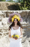 Portrait of young beautiful woman with circlet of flowers on her. Portrait of young beautiful woman circlet of flowers on head outdoors Royalty Free Stock Photography