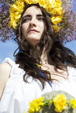 Portrait of young beautiful woman with circlet of flowers on her. Portrait of young beautiful woman circlet of flowers on head outdoors Royalty Free Stock Photos