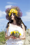 Portrait of young beautiful woman with circlet of flowers on her Royalty Free Stock Photo
