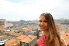 Portrait of young beautiful woman with cityscape of Porto, Portugal royalty free stock image