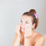Portrait of young beautiful woman cleaning her face Royalty Free Stock Images