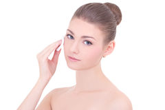 Portrait of young beautiful woman cleaning skin by cotton pad is Stock Photography