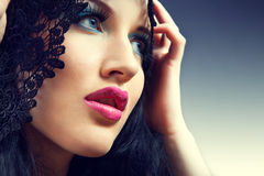 Portrait of young beautiful woman with colorful stylish make-up Stock Image