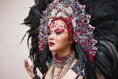 Portrait of a young beautiful woman in a creative look. The style of carnival and dancing. stock images