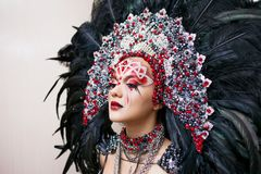 Portrait of a young beautiful woman in a creative look. The style of carnival and dancing. royalty free stock photos