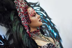 Portrait of a young beautiful woman in a creative look. The style of carnival and dancing. royalty free stock photography