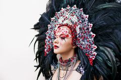 Portrait of a young beautiful woman in a creative look. The style of carnival and dancing. stock image