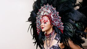 Portrait of a young beautiful woman in a creative look. The style of carnival and dancing. stock photo