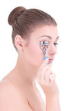 Portrait of young beautiful woman curling her eyelashes with eye Royalty Free Stock Photos