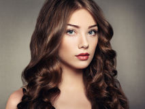 Portrait young beautiful woman with curly hair Royalty Free Stock Image