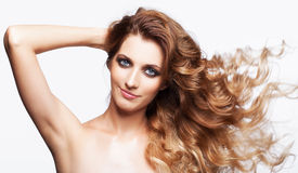 Portrait of young beautiful woman with curly shaggy fly-away hai Royalty Free Stock Photography