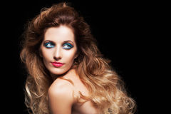 Portrait of young beautiful woman with curly shaggy hair style Royalty Free Stock Images