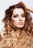 Portrait of young beautiful woman with curly shaggy hair style Royalty Free Stock Photos