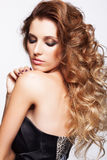 Portrait of young beautiful woman with curly shaggy hair style Stock Photography