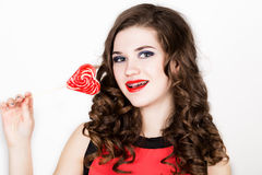 Portrait of young beautiful woman with dental braces holding sugarplum Royalty Free Stock Photos