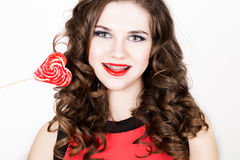 Portrait of young beautiful woman with dental braces holding sugarplum Royalty Free Stock Photography
