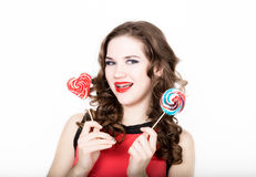 Portrait of young beautiful woman with dental braces holding sugarplum Stock Images