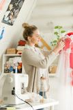 Portrait of a young beautiful woman dressing mannequin Stock Image