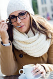 Portrait of young beautiful woman drinking coffee outdoor. Stock Photos