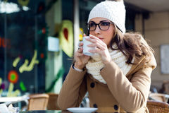 Portrait of young beautiful woman drinking coffee outdoor. Stock Photography
