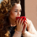 Portrait of young beautiful woman drinking coffee or tea outdoor Stock Photos