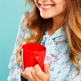 Portrait of young beautiful woman drinking coffee or tea over bl Stock Images