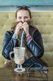 Portrait of young beautiful woman drinking tea cappuccino in trendy cafe shop. Stock Image