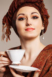 Portrait of a young beautiful woman in eastern style Stock Photography