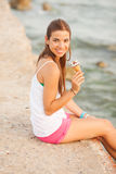 Portrait of a young beautiful woman eating ice-cream cone Royalty Free Stock Photography